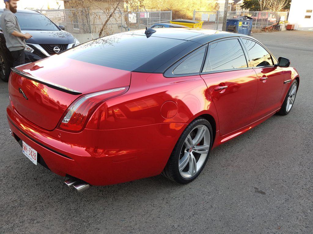 Laminated red conform chrome Jaguar XJR vinyl wrap w/ black accents