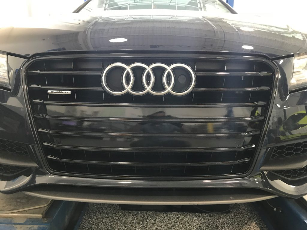 Full black-out wrap on Audi Grille